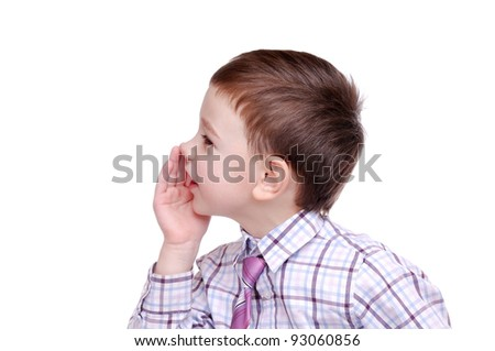 Closeup portrait of a boy whispering gossips against white background - stock photo