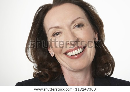Closeup portrait of a businesswoman smiling on white background - stock photo