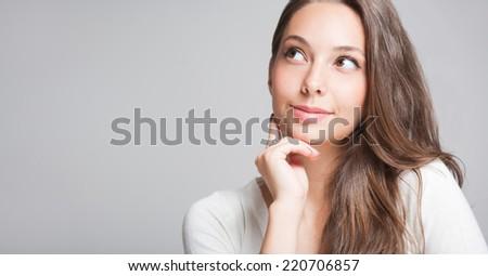 Closeup portrait of a cheerful friendly brunette. - stock photo