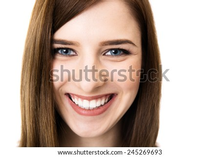 Closeup portrait of a cheerful woman over white background - stock photo