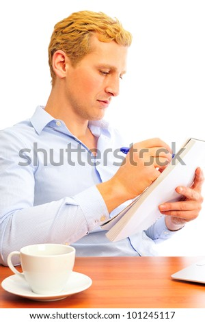 Closeup portrait of a cheerful young business man signing documents - stock photo