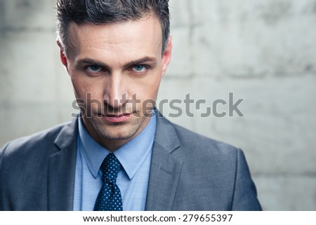 Closeup portrait of a confident businessman looking at camera - stock photo