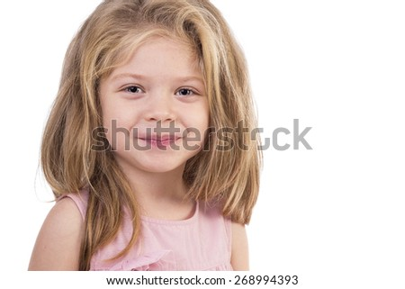 Closeup portrait of a cute little girl against white background - stock photo