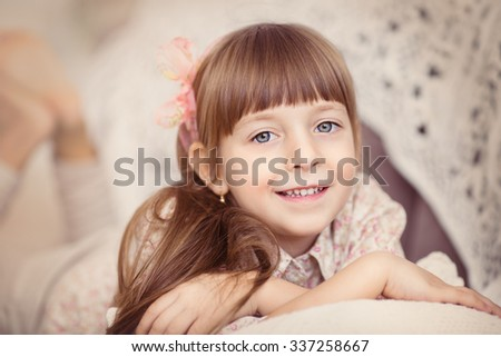Closeup portrait of a cute Little girl is daydreaming - stock photo