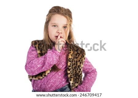 Closeup portrait of a cute little girl making silence sign over white background - stock photo