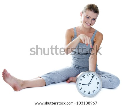 Closeup portrait of a cute young woman on the bed - stock photo