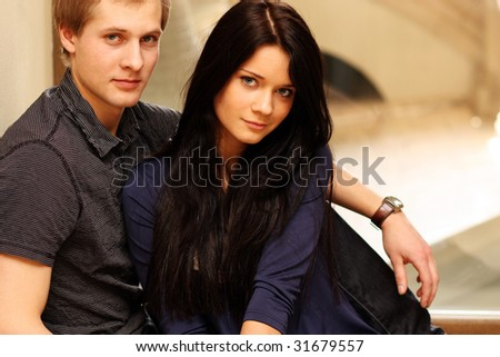 Closeup portrait of a cute young woman with her boyfriend - stock photo