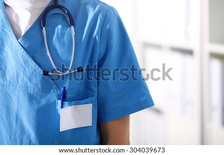 Closeup portrait of a  doctor with stethoscope holding folder - stock photo