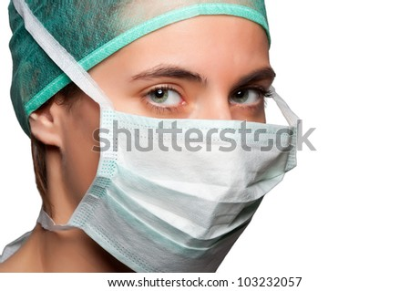 Closeup portrait of a female surgeon isolated in a white background - stock photo