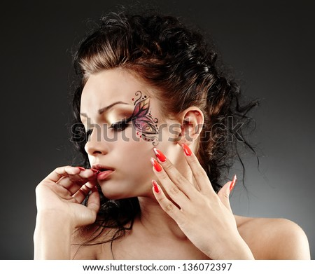 Closeup portrait of a glamour woman with facial painting - stock photo