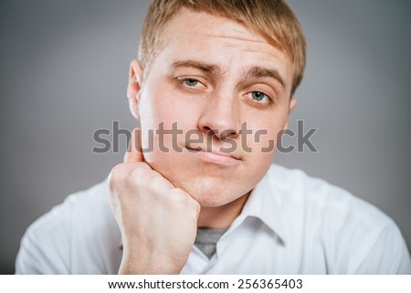 Closeup portrait of a groggy upset worried sad, depressed, tired business man with a headache and very stressed hand in hair, isolated , Negative human emotion facial expression - stock photo