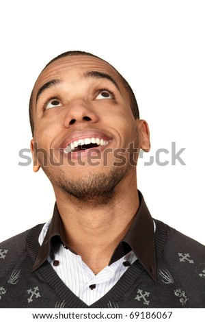 Closeup portrait of a happy african-american man looking up at copyspace - stock photo