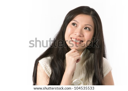 Closeup Portrait of a happy Asian woman looking up into the corner. - stock photo