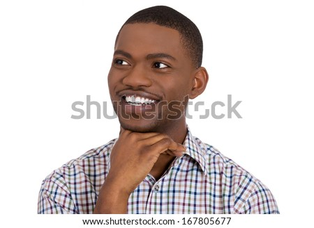 Closeup portrait of a happy guy, young handsome man looking sideways dreaming, remembering good times hand on chin, isolated on white background. Positive human emotions, facial expression, feelings - stock photo