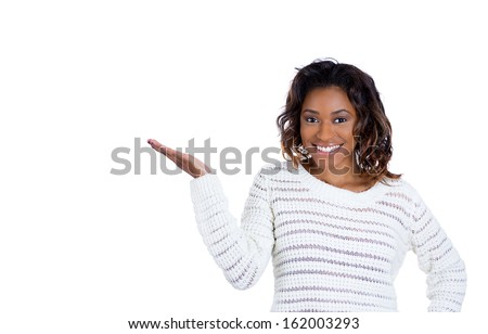 Closeup portrait of a happy young beautiful smiling woman showing blank area with hands, isolated on white background with copy space. Positive human emotion facial expressions signs and symbols - stock photo