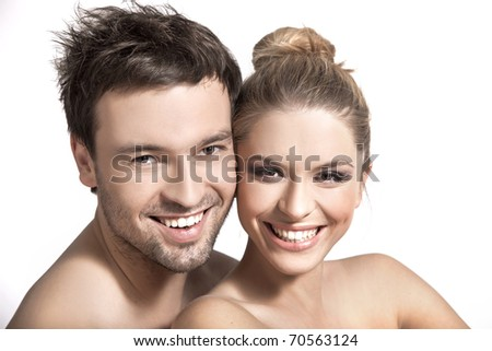 Closeup portrait of a happy young couple - stock photo