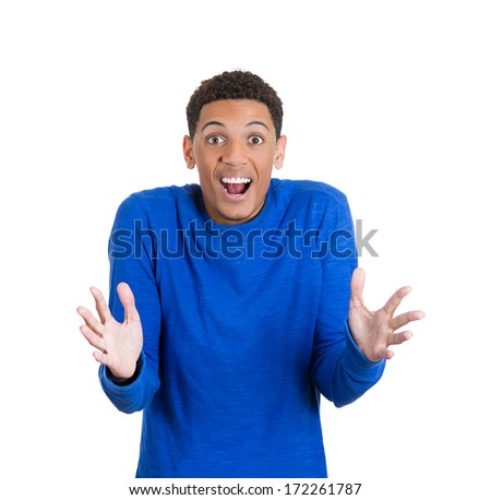 Closeup portrait of a happy young smiling handsome man looking shocked and surprised in full disbelief hands up in air, isolated on white background. Positive human emotion facial expression feeling - stock photo