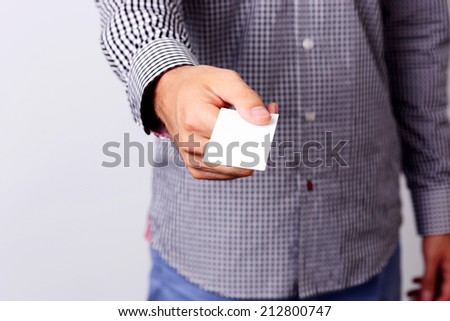 Closeup portrait of a male hand giving blank credit card - stock photo