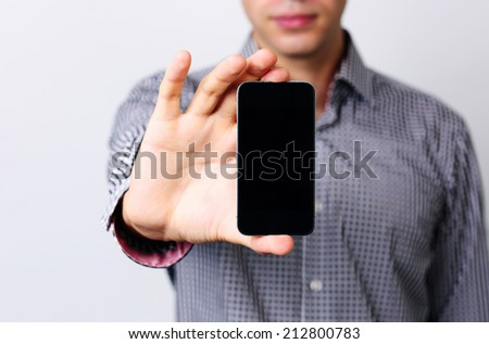 Closeup portrait of a male hands holding smartphone - stock photo