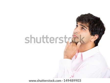 Closeup portrait of a man resting chin on hand, brows raised and daydreaming, staring thoughtfully upwards, copy space to left, isolated on white background - stock photo