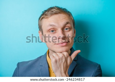 Closeup portrait of a man resting chin on hand, brows raised and daydreaming, staring thoughtfully - stock photo