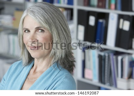 Closeup portrait of a middle aged businesswoman smiling  - stock photo