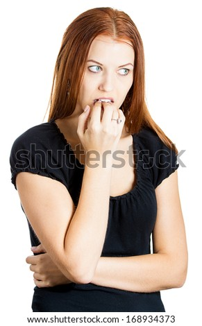 Closeup portrait of a nervous woman biting her fingernails craving for something or anxious, isolated on white background. Negative human emotions facial expressions feelings - stock photo