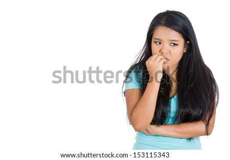 Closeup portrait of a nervous woman biting her nails craving for something or anxious, isolated on white background with copy space - stock photo