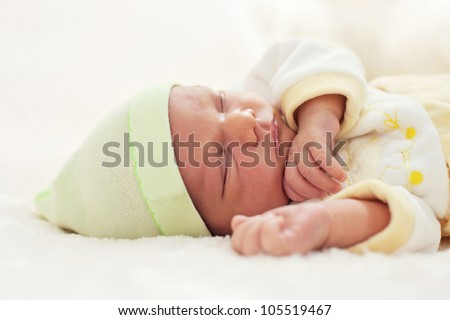 Closeup portrait of a one week old baby boy asleep - stock photo