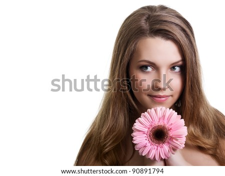 closeup portrait of a pretty young woman holding pink flower - stock photo