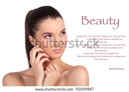 Closeup portrait of a pretty young woman, touching her face and looking sideways. High resolution image taken in studio. Isolated on pure white background with copy space for your ad. - stock photo