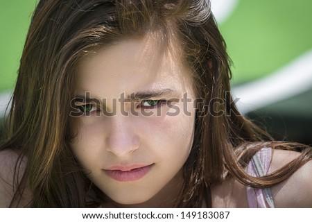 closeup portrait of a sad, angry teenage girl. - stock photo
