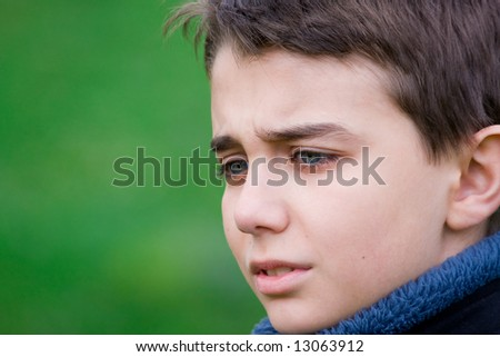 Closeup portrait of a sad teenager - stock photo