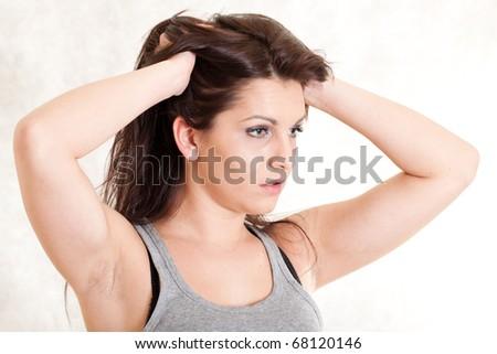Closeup portrait of a sad young woman - stock photo