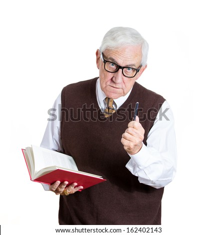 Closeup portrait of a senior elderly  teacher holding a book and a pen, looking very serious, unhappy and grumpy, isolated on white background. Human emotions and facial expressions. Education concept - stock photo