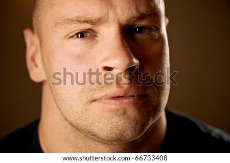 Closeup portrait of a serious handsome young man - stock photo