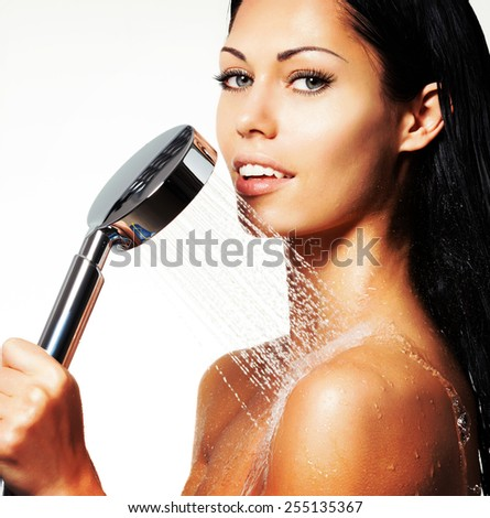 Closeup portrait of a sexy beautiful woman holds shower in hands   - stock photo