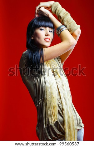 Closeup portrait of a sexy female model posing against red background - stock photo