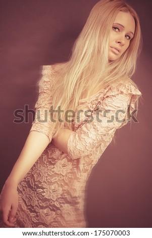 Closeup portrait of a sexy young female fashion model posing - stock photo