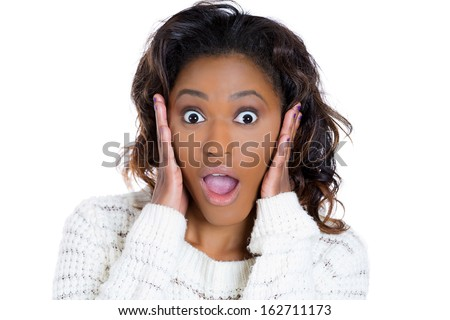 Closeup portrait of a shocked , surprised, astonished, amazed young beautiful woman, holding her head, and open mouthed, isolated on a white background. Human emotions and facial expressions. - stock photo