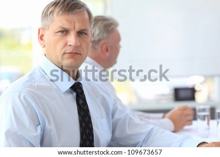 Closeup portrait of a smart mature business man - stock photo