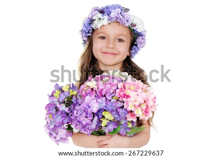 closeup portrait of a smiling girl holding flowers bouquet - stock photo