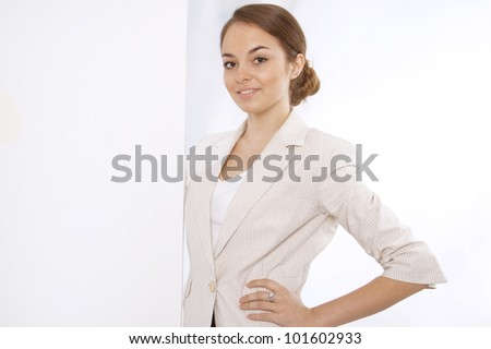 Closeup portrait of a smiling young business woman with a white banner - stock photo