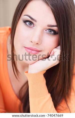 Closeup portrait of a smiling young woman at home - stock photo