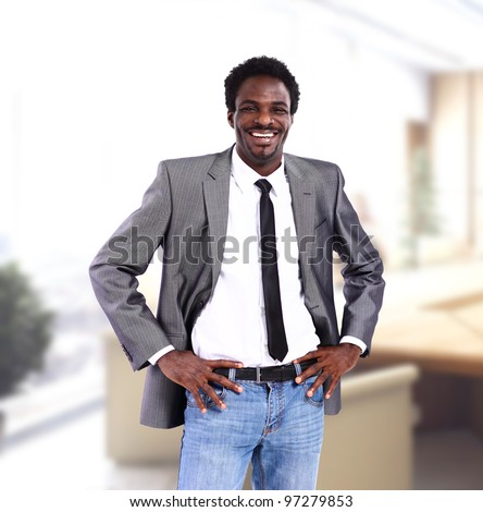 Closeup portrait of a successful African American business man in office - stock photo