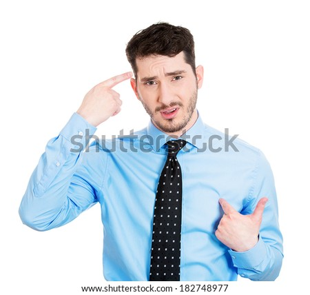 Closeup portrait of a surprised angry young man asking question you talking to, mean me? Are you crazy? Isolated on white background. Negative emotions, facial expressions, feelings, reaction - stock photo