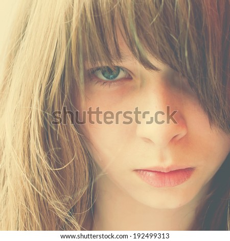 Closeup Portrait of a Teenage Girl with long bang; toning effect - stock photo