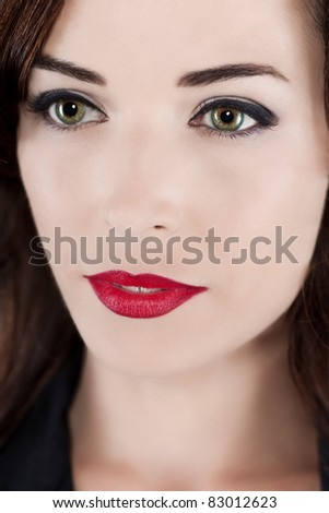 Closeup portrait of a thoughtful beautiful woman with green eyes and red lips - stock photo