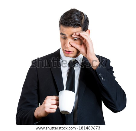 Closeup portrait of a very tired, falling asleep business young man no energy motivation, struggling not to crash and stay awake, keeping his eyes opened, isolated white background. Human emotions - stock photo