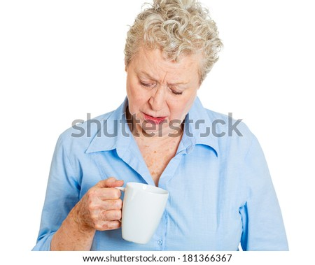 Closeup portrait of a very tired, falling asleep senior mature woman no energy motivation, struggling not to crash and stay awake, keeping her eyes opened, isolated white background. Human emotions - stock photo